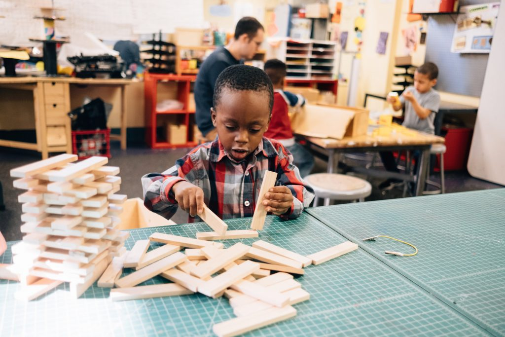 Young boy playing with building blocks at the Hosanna House in Wilkinsburg, PA.