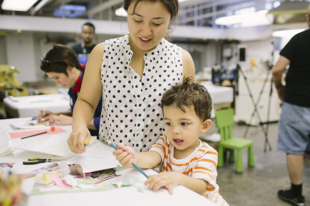 Mother and young child play with activity at maker culture in Pittsburgh