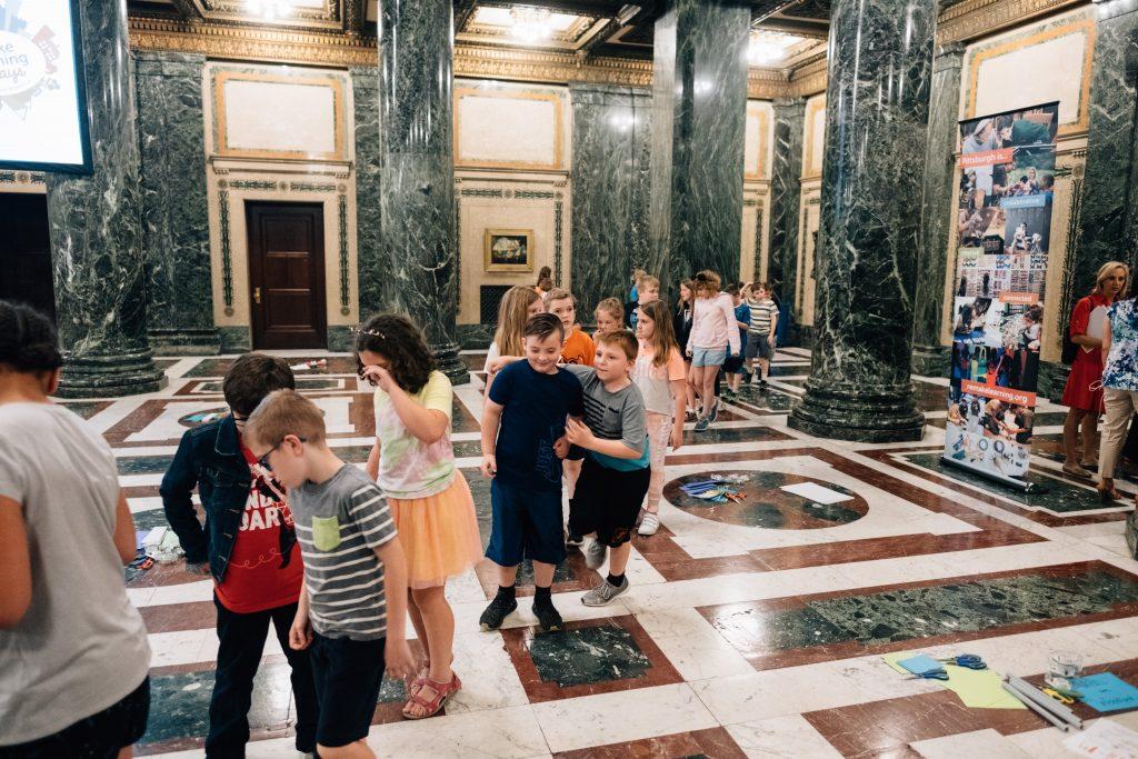 Train of children taking tour of museum